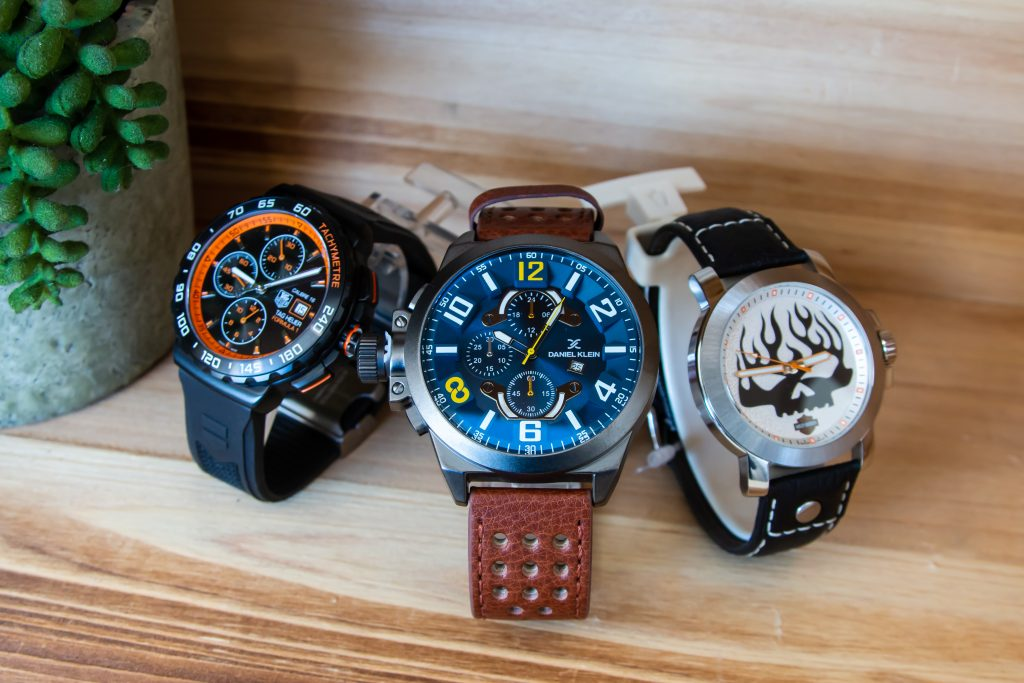 3 Watches on wooden table