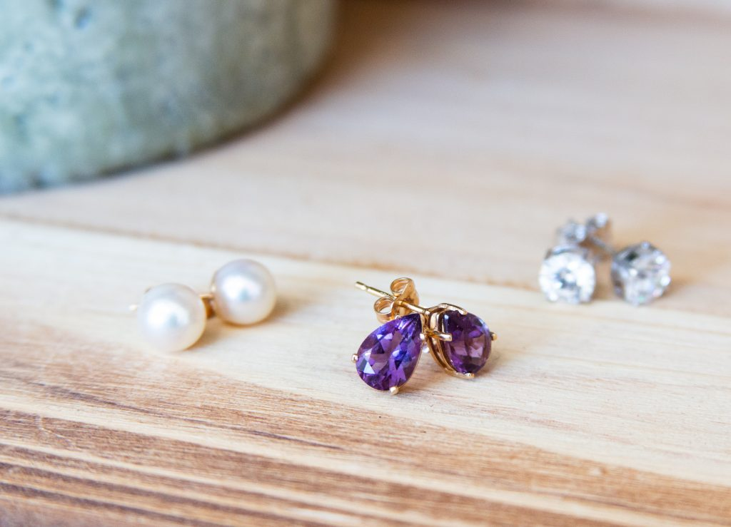 3 Pairs of Earrings on wooden table