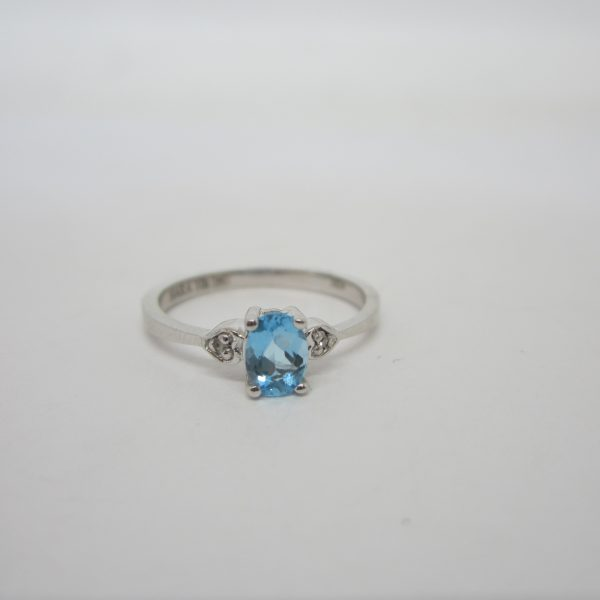 white gold ring with an oval blue topaz set
