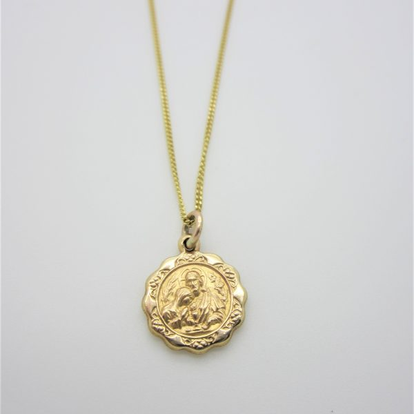 yellow gold religious charm