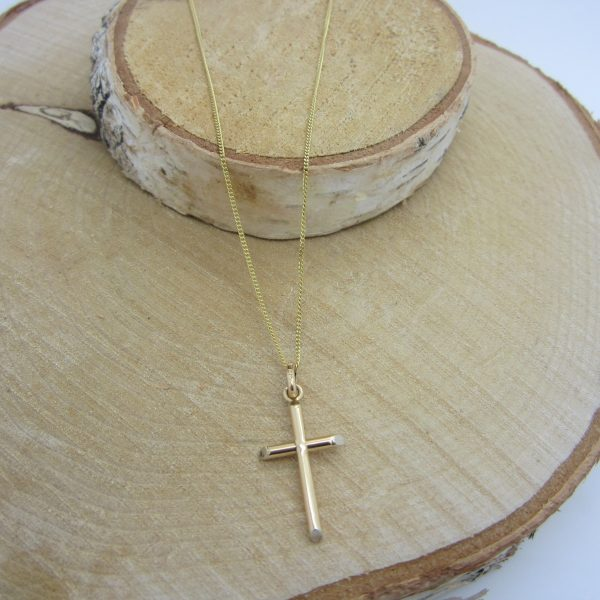 Yellow gold cross charm