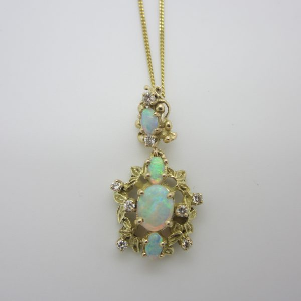 gold pendant with opals and diamonds